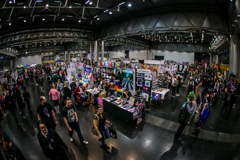 An image of the Vienna Comic Con Artist Alley and a text with description of the event